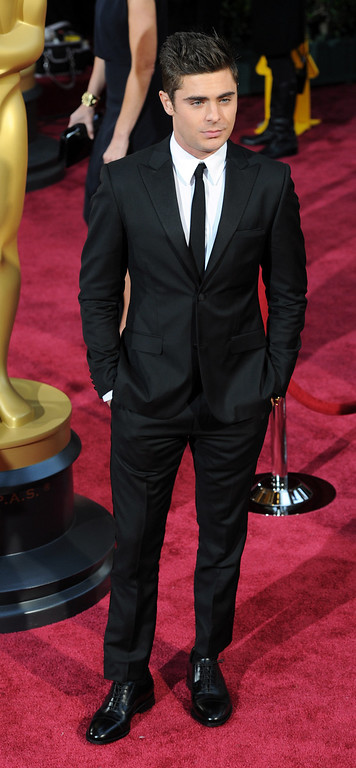 . Zac Efron attends the 86th Academy Awards at the Dolby Theatre in Hollywood, California on Sunday March 2, 2014 (Photo by John McCoy / Los Angeles Daily News)