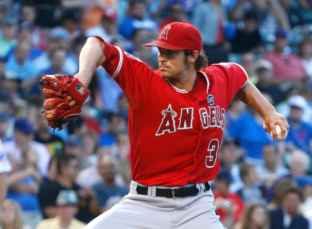 . Los Angeles Angels starting pitcher C.J. Wilson delivers during the first inning of an interleague baseball game against the Chicago Cubs on Wednesday, July 10, 2013, in Chicago. (AP Photo/Charles Rex Arbogast)