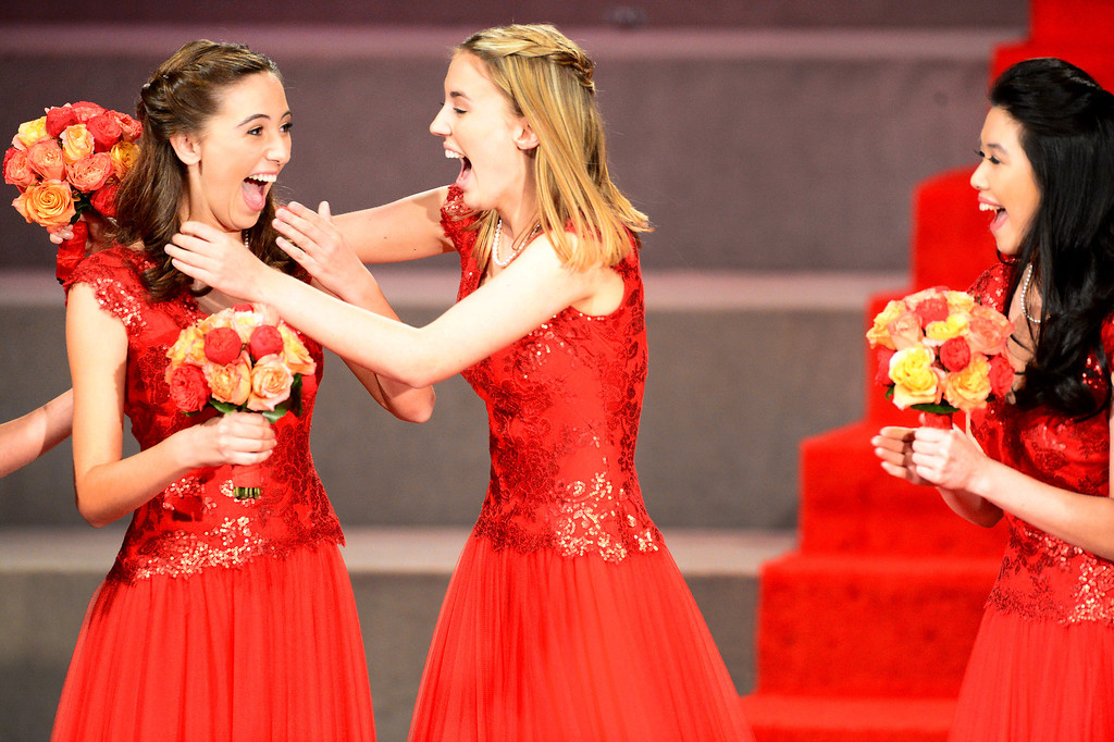 . Princess Katherine Lipp, center congratulates Ana Acosta, left, as she is named the 96th Rose Queen during the Tournament of Roses\' coronation ceremony Thursday night, October 24, 2013 at the First Church of the Nazarene of Pasadena. Princess Elyssia Widjaja is right. (Photo by Sarah Reingewirtz/Pasadena Star-News)