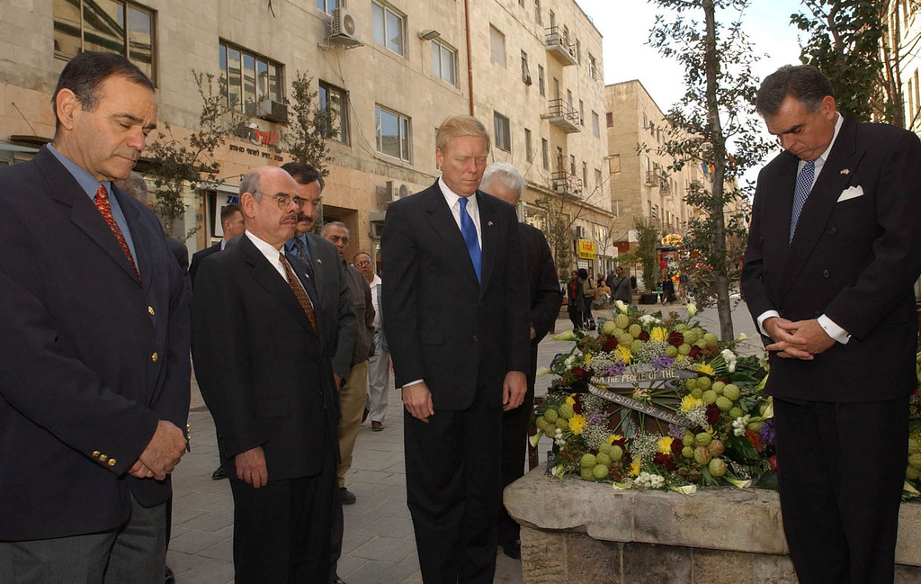 . Congressman Henry Waxman (D-A) (2nd, L), U.S House Minority Leader Richard Gephardt (D-MO) (C), and Congressman Ray Lahood (R-IL) (R), stand for a moment of silence after laying a memorial wreath on the site of the suicide bombing on the pedestrian mall, January 16, 2002 in Jerusalem. Gephardt and a U.S. delegation were on a tour of the Middle East to discuss the U.S. anti-terror campaign with officials. (Photo by Getty Images)