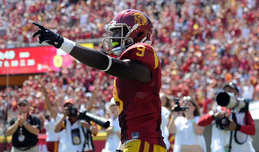 . Southern California wide receiver Marqise Lee (9) reacts after catching a pass and runs for a 80 touchdown against Boston College during the first half of an NCAA college football game in the Los Angeles Memorial Coliseum in Los Angeles, on Saturday, Sept. 14, 2013.  (Photo by Keith Birmingham/Pasadena Star-News)