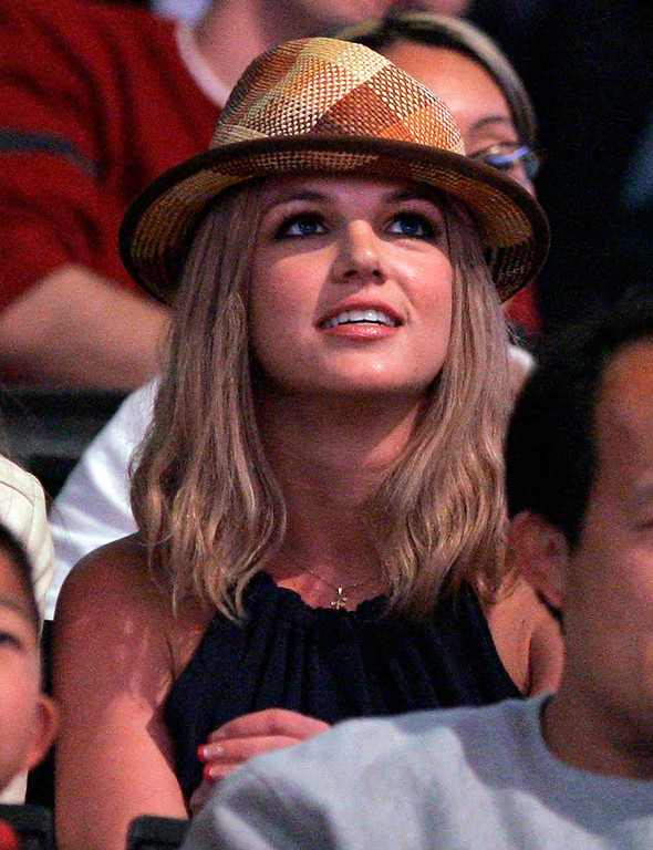 . Singer Britney Spears watches the Houston Rockets play the Los Angeles Lakers during  their NBA basketball game in this  March 30, 2007 file photo in Los Angeles. A bodyguard for Britney Spears must face a battery charge after he scuffled with two men trying to photograph the singer and her young sons at a Las Vegas Strip resort, police said Friday, July 27, 2007.  The bodyguard, Cesar Julio Camera, 37, was accused of grabbing and punching one photographer and pushing another into a wall about 11:30 a.m. Thursday at the spa at the Wynn Las Vegas hotel-casino.    (AP Photo/Mark J. Terrill, FILE)