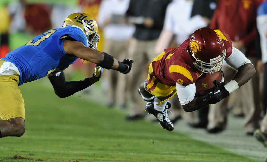 . UCLA #23 Anthony Jefferson chases USC Marqise Lee out of bounds in the 4rd quarter. UCLA defeated USC 35 to 14 in a matchup of cross town rivals at the Los Angeles Memorial Coliseum in Los Angeles, CA.  photo by (John McCoy/Los Angeles Daily News)