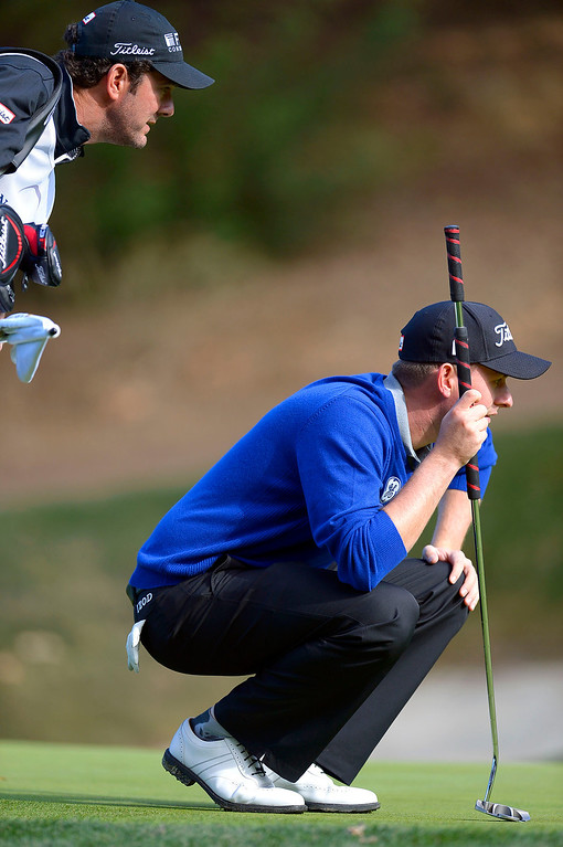 . Webb Simpson lines up a putt on the 5th green during the first-round of Tiger Woods\' Northwestern Mutual World Challenge at Sherwood Country Club in Thousand Oaks, CA Thursday December 5, 2013.(Andy Holzman/Los Angeles Daily News)