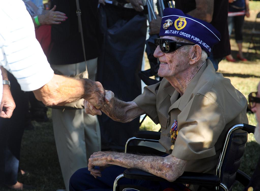 . Marine Veteran Lee Bergee who served in World War II, the Korean War and Vietnamt, shakes hands during the Veterans Day cermony at Jennie Davis Park in Redlands, Monday, Nov. 11, 2013. (John Valenzuela/Staff Photographer)