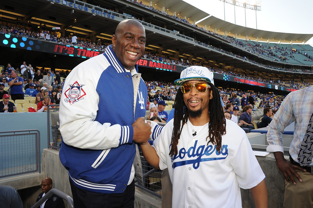 """. In this handout photo provided by the Los Angeles Dodgers, Lil Jon (R), rapper, record producer, entrepreneur and international DJ who was a member of the group Lil Jon & The East Side Boyz, threw the ceremonial first pitch during the Los Angeles Dodgers vs St. Louis Cardinals game and poses with Los Angeles Dodgers owner Earvin \""""Magic\"""" Johnson on May 24, 2013 in Los Angeles, California.  Lil Jon also announced the Dodgers� starting lineup.  (Photo by Jon SooHoo/Los Angeles Dodgers, LLC via Getty Images)"""