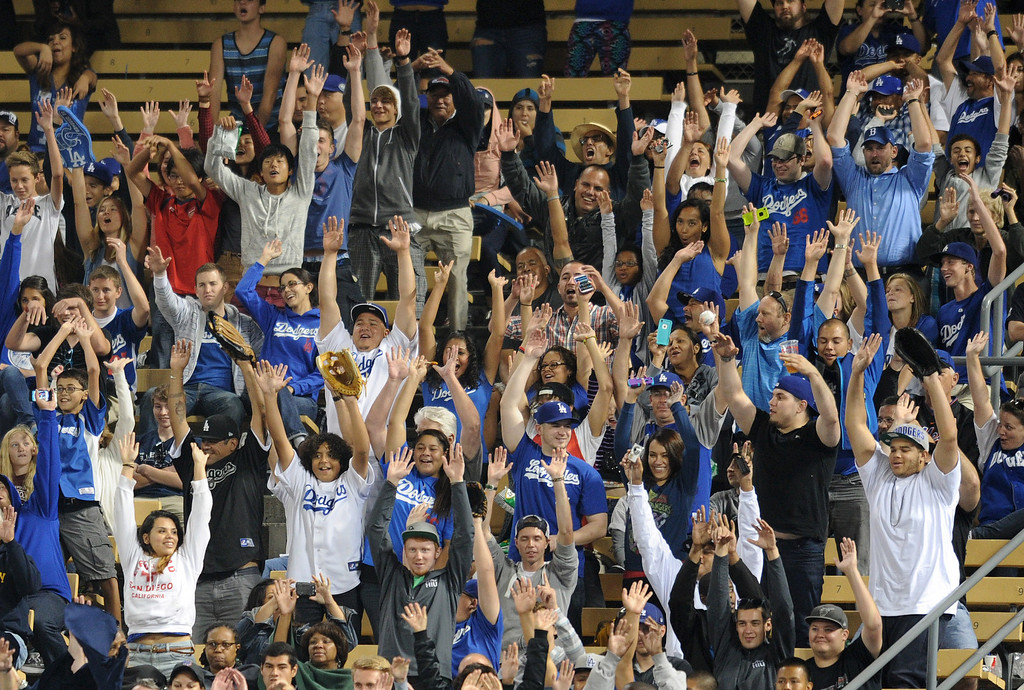 ". Fans in the Right Field Pavilion cheer during a ""Wave.\"" The fans at Dodger Stadium have been treated to a lot of excitement. The Dodgers defeated the New York Mets 5-4 in 12 innings Wednesday night at Dodger Stadium in Los Angeles, CA. 8/14/2013  (John McCoy/LA Daily News)"