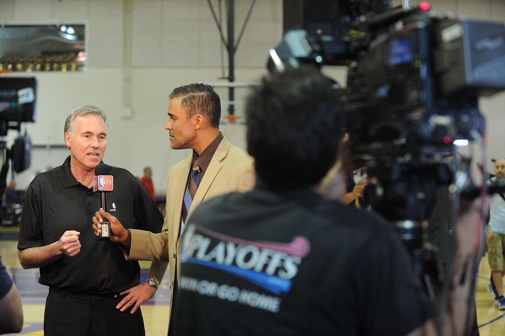 . Mike D\'Antoni is interviewed by former Laker and current NBA TV reporter Rick Fox.The Los Angeles Lakers held a media day at their El Segundo practice facility. Players were photographed for team materials, and interviewed by the press. El Segundo, CA. 9/27/2013. (John McCoy/Los Angeles Daily News)