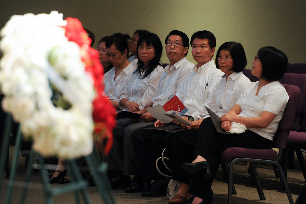 """. Members of the Chinese Christian Alliance Church choir sing \""""Amazing Grace\"""" sit by a wreath during a prayer vigil at West Valley Christian School, Thursday, July 11, 2013, in honor of the crash victims of Asiana Flight 214 airliner that crashed at San Francisco Airport. (Michael Owen Baker/L.A. Daily News)"""