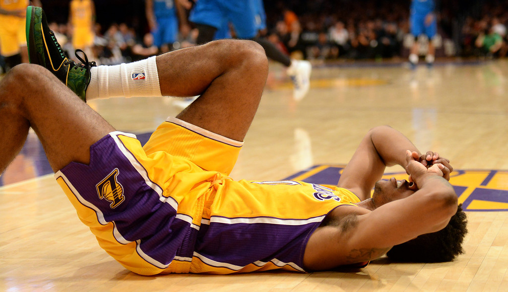 . Los Angeles Lakers forward Nick Young injures his leg in the second half during an NBA basketball game against the Dallas Mavericks in Los Angeles, Calif., on Friday, April 4, 2014. Dallas Mavericks won 107-95.  (Keith Birmingham Pasadena Star-News)