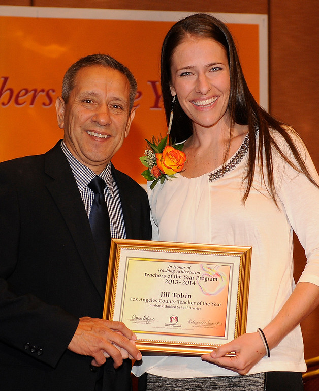 . L.A. County Supt. of Schools Dr. Arturo Delgado gives recognition to teacher of the year from Burbank UDS, Jill Tobin. Sixteen teachers from throughout the Los Angeles County were named as Teachers of the Year during a ceremony at the Universal Hilton. Teachers received a cash award from the California Credit Union as well as software and hardware to use in their classrooms from eInstruction. Universal City, CA. 9/27/2013. photo by (John McCoy/Los Angeles Daily News)