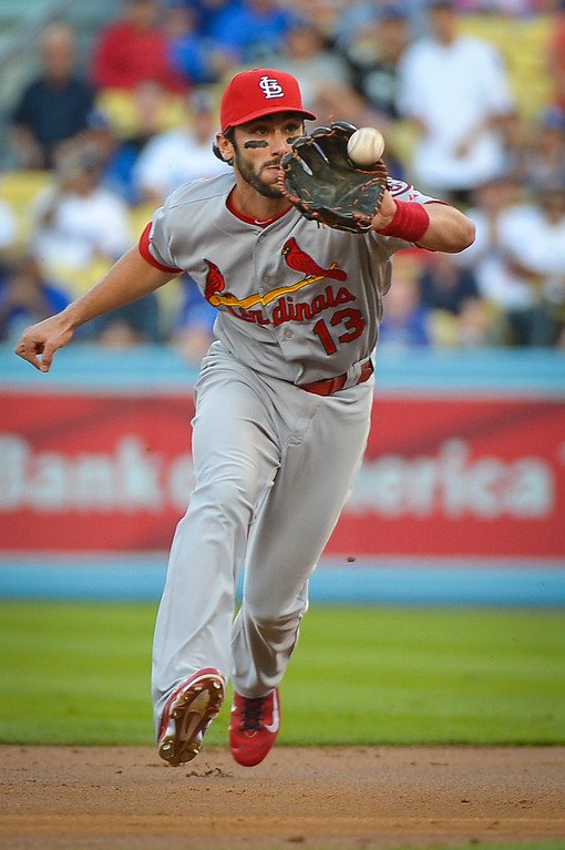 . Cardinals\' Matt Carpenter fields a sort hopper in the NLCS game 3 at Dodger Stadium Monday, October 14, 2013 ( Photo by Andy Holzman/Los Angeles Daily News )