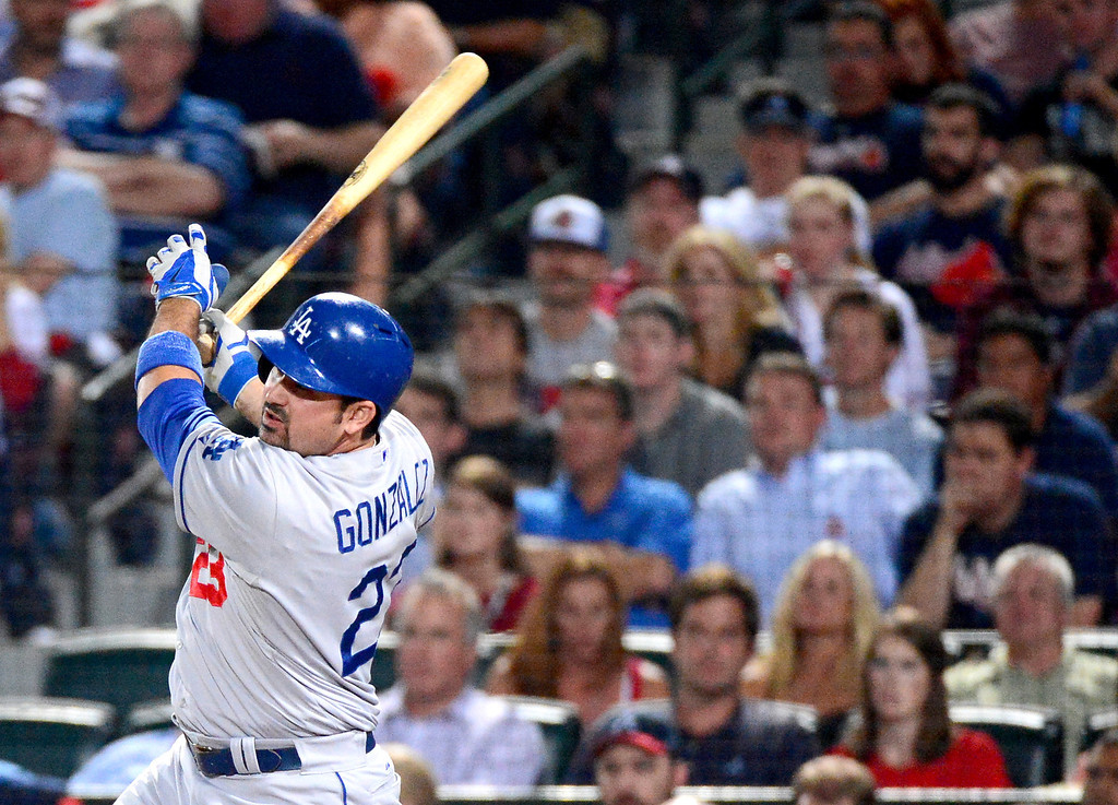 . Los Angeles Dodgers\' Adrian Gonzalez hits a home run bringing the score to 4-0 as they play the Atlanta Braves in the first game of the playoffs Thursday, October 3, 2013 at Turner Field in Atlanta, Georgia. (Photo by Sarah Reingewirtz/Pasadena Star- News)