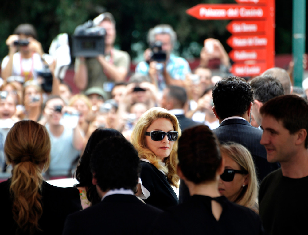 . US singer Madonna, centre, arrives at the 68th edition of the Venice Film Festival in Venice, Italy, Thursday, Sept. 1, 2011. (AP Photo/Luigi Costantini)