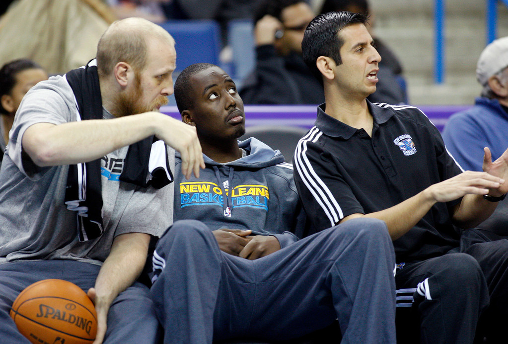 . New Orleans Hornets center Chris Kaman, left, talks to forward Al-Farouq Aminu, center, and assistant coach James Borrego during an NBA basketball scrimmage at the New Orleans Arena in New Orleans, Saturday, Dec. 17, 2011. (AP Photo/Jonathan Bachman)