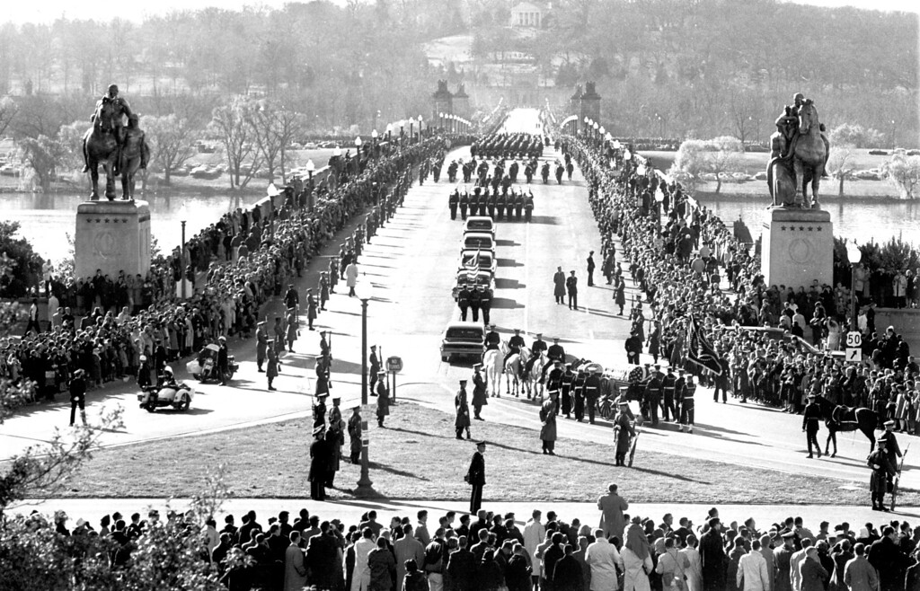 . The horse-drawn caisson bearing the body of the late President John F. Kennedy turns into Memorial Bridge on the way to Arlington National Cemetery.   Los Angeles Daily News file photo