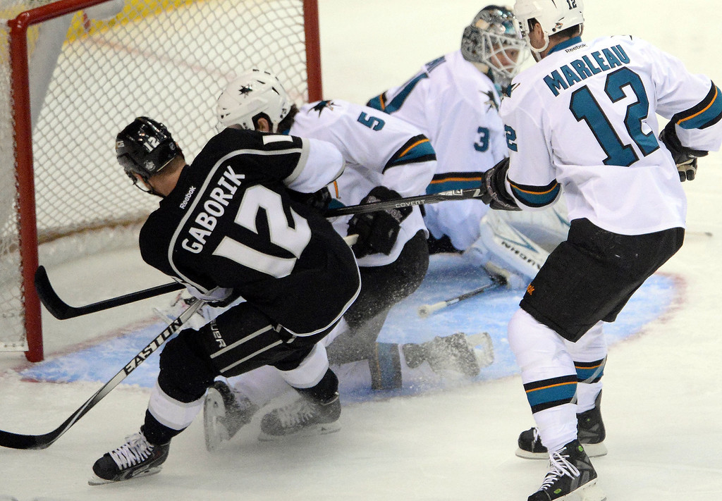 . Los Angeles Kings right wing Marian Gaborik (12) scores past San Jose Sharks goalie Antti Niemi (31) during the first period in Game 4 of an NHL hockey first-round playoff series at Staples Center in Los Angeles on Thursday, April, 24  2014.  (Keith Birmingham Pasadena Star-News)