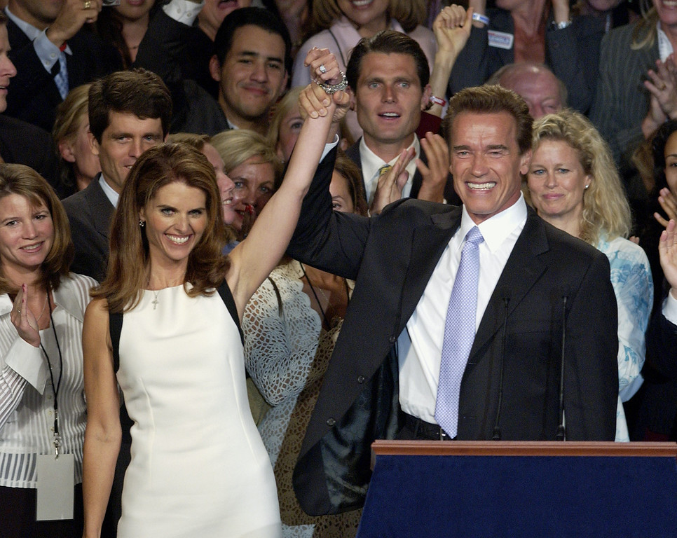 . Arnold Schwarzanegger is joined by wife Maria Shriver as he celebrates his victory in the California gubernatorial recall election in Los Angeles, Tuesday, Oct. 7, 2003. (AP Photo/Mark J. Terrill)
