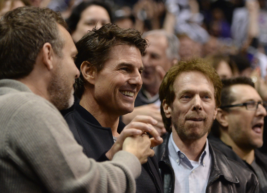 . LOS ANGELES, CA - MAY 23:  Actor Tom Cruise and director Jerry Bruckheimer celebrate an empty net goal of Jeff Carter #77 of the Los Angeles Kings on way to a 3-0 win over the San Jose Sharks in Game Five of the Western Conference Semifinals during the 2013 Stanley Cup Playoffs at Staples Center on May 23, 2013 in Los Angeles, California.  (Photo by Harry How/Getty Images)