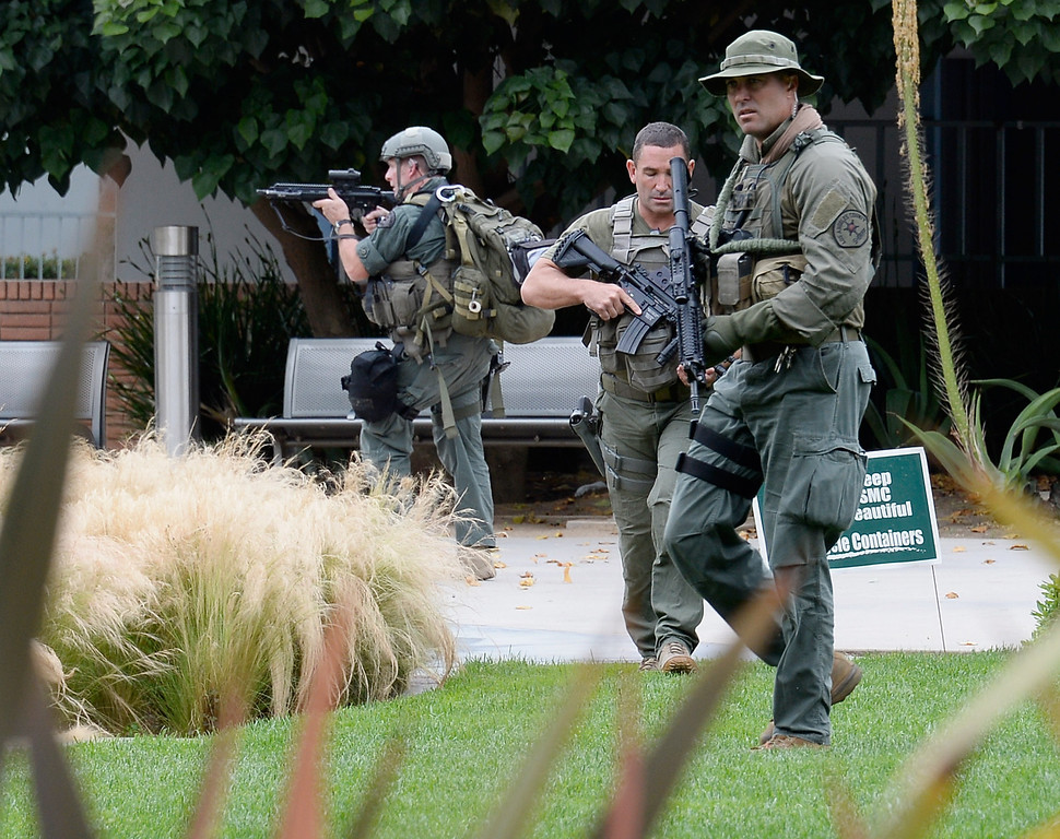 . SANTA MONICA, CA - JUNE 07:  Los Angeles County Sheriff deputies search the grounds of Santa Monica College near the library after multiple shootings  were reported on the campus June 7, 2013 in Santa Monica, California.  According to reports, at least three people have been injured, and a suspect was taken into custody. (Photo by Kevork Djansezian/Getty Images)