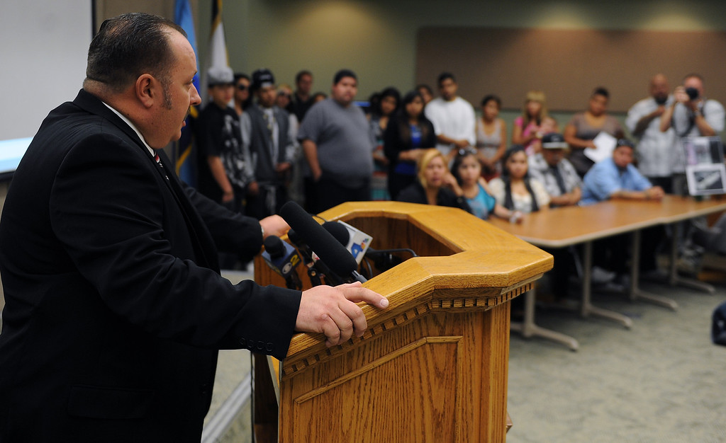 . San Bernardino County Sheriff\'s Detective, Matthew Peterson speaks to the media during a press conference at the San Bernardino County Sheriff\'s Headquarters Thursday August 22, 2013  about the August 22, shooting death of Daniel Olivera 26, of Hesperia at the AM/PM Arco gas station in Victorville.LaFonzo Carter/Staff Photographer