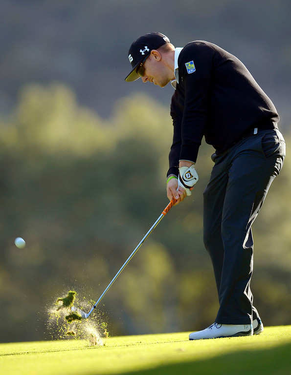 . Hunter Mahan hits a shot on the 18th hole during the first-round of Tiger Woods\' Northwestern Mutual World Challenge at Sherwood Country Club in Thousand Oaks, CA Thursday December 5, 2013.(Andy Holzman/Los Angeles Daily News)