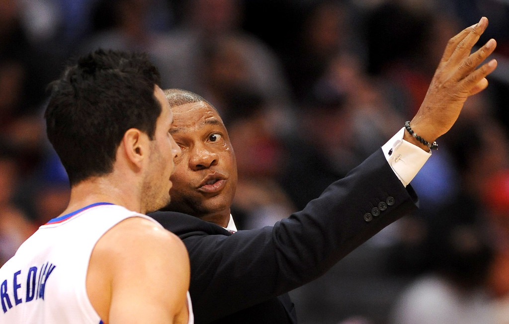 . Los Angeles Clippers\' head coach Doc Rivers talks to J.J. Redick during the first half Monday, Nov. 18, 2013, in Los Angeles.  The Clippers lost the game 106-102.(Andy Holzman/Los Angeles Daily News)