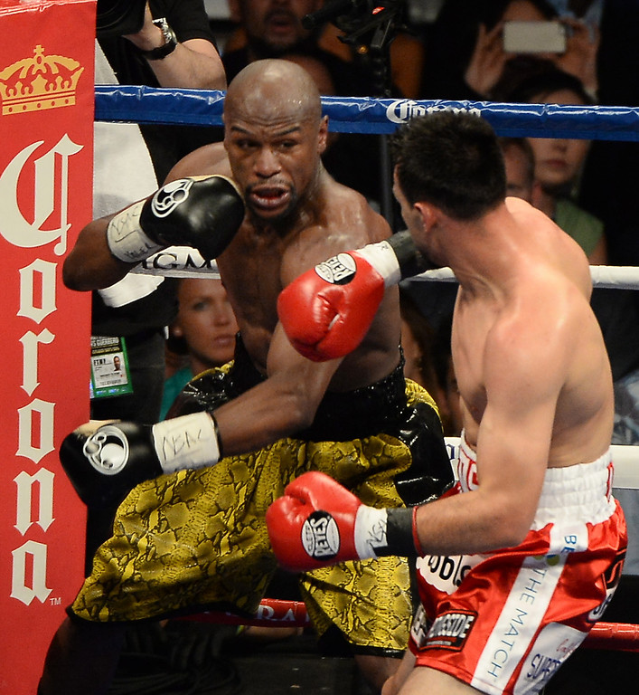 . May 4,2013. Las Vegas NV. (in gold Trunks)  Floyd Mayweather goes 12 rounds with Robert Guerrero Saturday night. Floyd Mayweather took the win by unanimous decision for the WBC & Vacant Ring Magazine welterweight title at the MGM grand hotel in Las Vegas. Photo by Gene Blevins/LA DailyNews