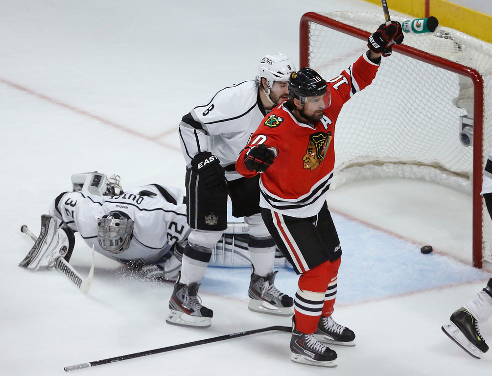 . Chicago Blackhawks center Patrick Sharp (10) reacts after scoring a goal against Los Angeles Kings goalie Jonathan Quick (32) during the second period in Game 1 of the NHL hockey Stanley Cup Western Conference finals Saturday, June 1, 2013, in Chicago. (AP Photo/Charles Rex Arbogast)