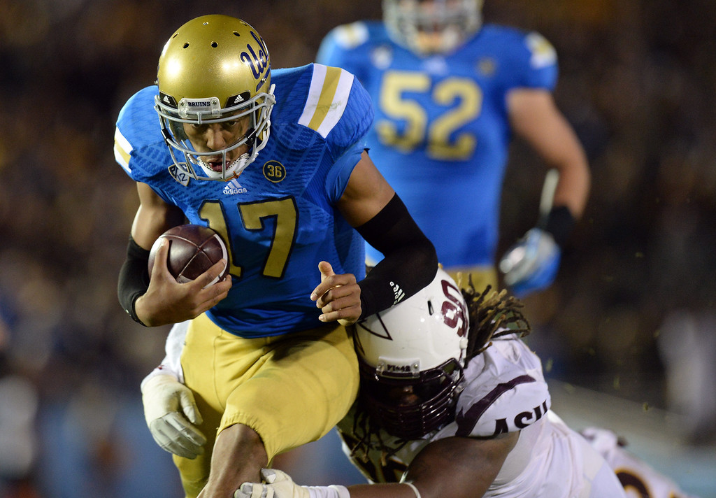 . UCLA�s Brett Hundley #17 is dragged down by Arizona State�s Will Sutton #90 during their game at the Rose Bowl Saturday November 23, 2013. Arizona State beat UCLA 38-33. (Photos by Hans Gutknecht/Los Angeles Daily News)