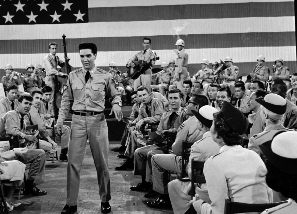". The nation\'s new 50-star flag makes its film debut July 4, 1960 as a backdrop for a movie by Paramount Pictures. Far too large ever to be flown, the 21-by-42 silk flag with 14-inch stars and 18-inch wide stripes was made up for this scene starring Elvis Presley, left center, in Hal Wallis\'  ""G.I. Blues\"". (AP photo/ho)"