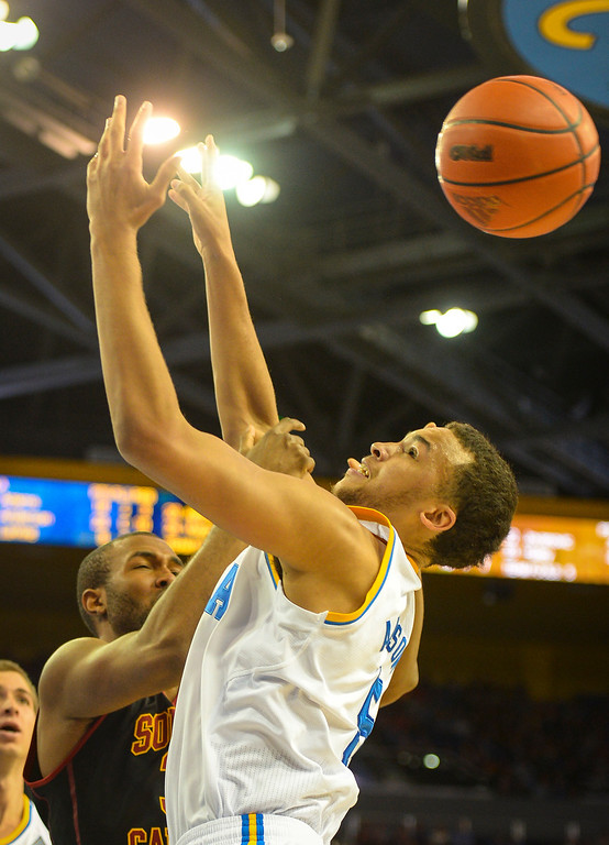 . UCLA�s Kyle Anderson is fouled by USC�s D.J. Haley during game action at Pauley Pavilion Sunday, December 5, 2014. UCLA  defeated USC 107-73.  Photo by David Crane/Los Angeles Daily News.