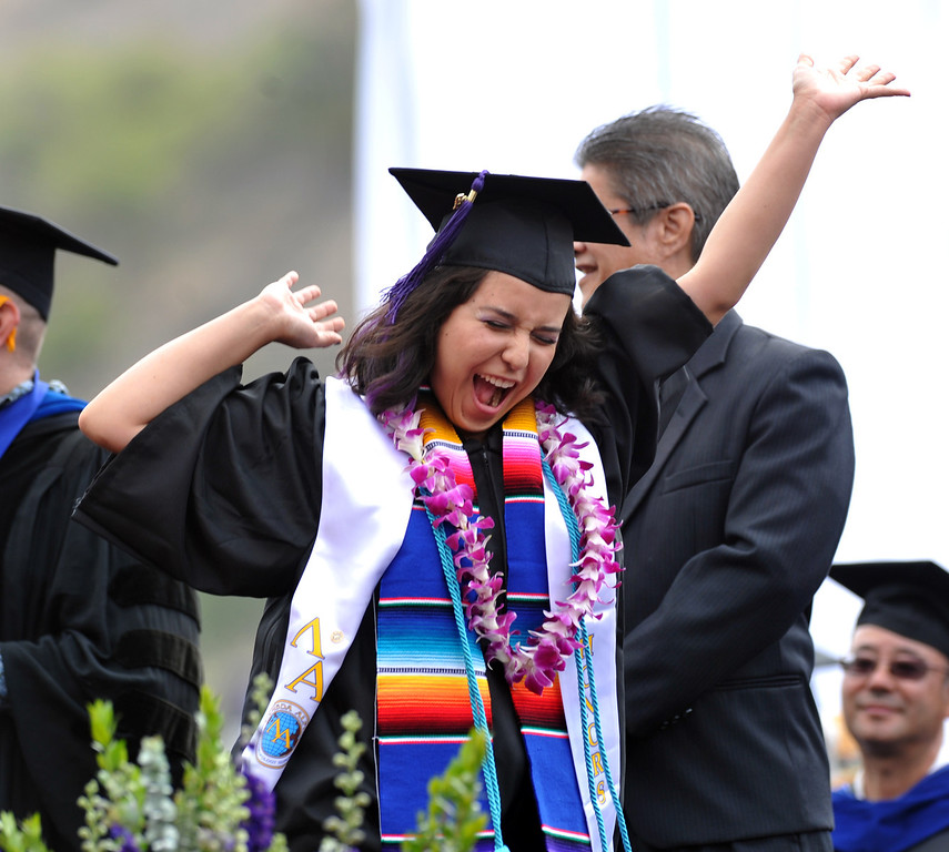 . Alyssa Castaneda dances as her name is announced during the 110th Commencement Ceremony at Memorial Stadium on the Whittier College campus in Whittier on Friday May 17, 2013. Award-winning journalist Sonia Nazario gave the keynote address and received an honorary degree from the Whittier College faculty: a doctorate of humane letters.(SGVN/Staff Photo by Keith Durflinger)