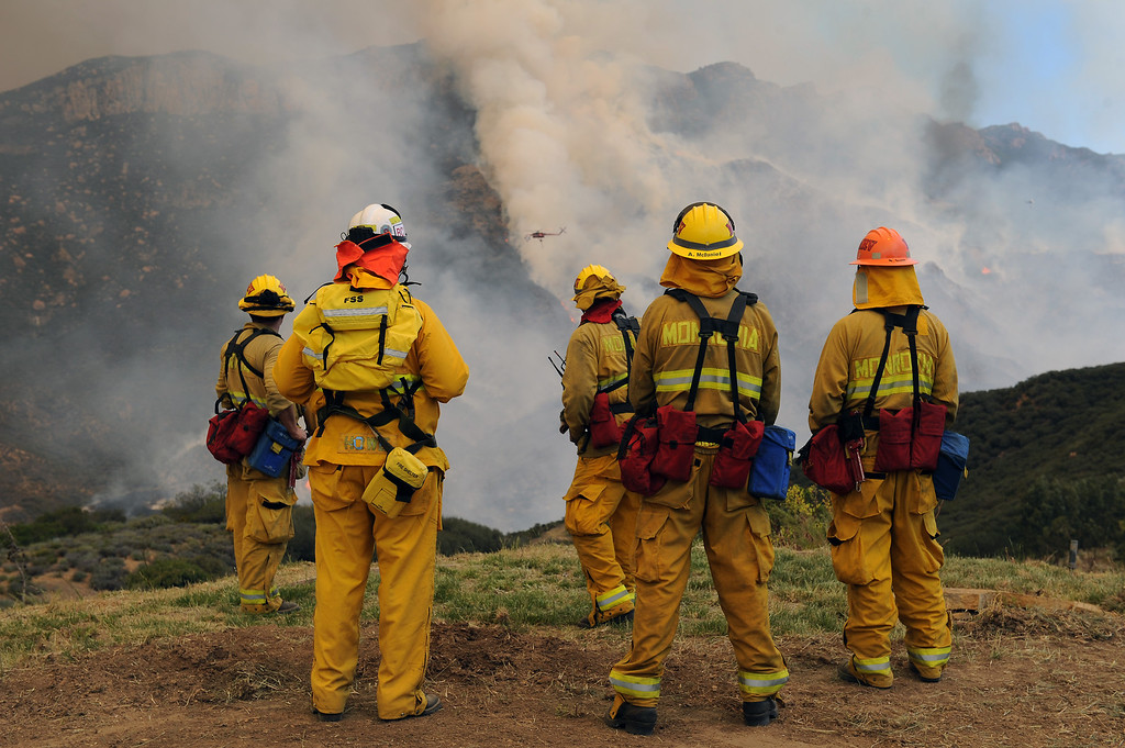 . Monrovia firefighters watch a hillside flare up in Ventura County, Friday, May 3, 2013. (Michael Owen Baker/Los Angeles Daily News)