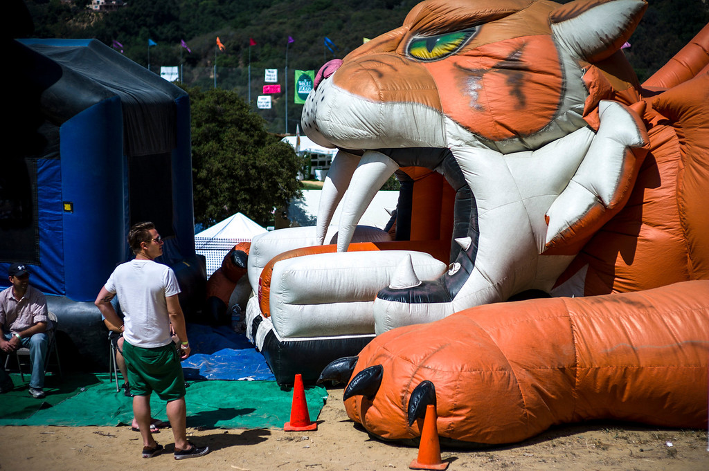 . The eye of the tiger bouncer greets visitors at the 40th annual Topanga Days celebration in Topanga Sunday.  The celebration continues Monday with more bands scheduled to perform.   Photo by David Crane/Los Angeles Daily News
