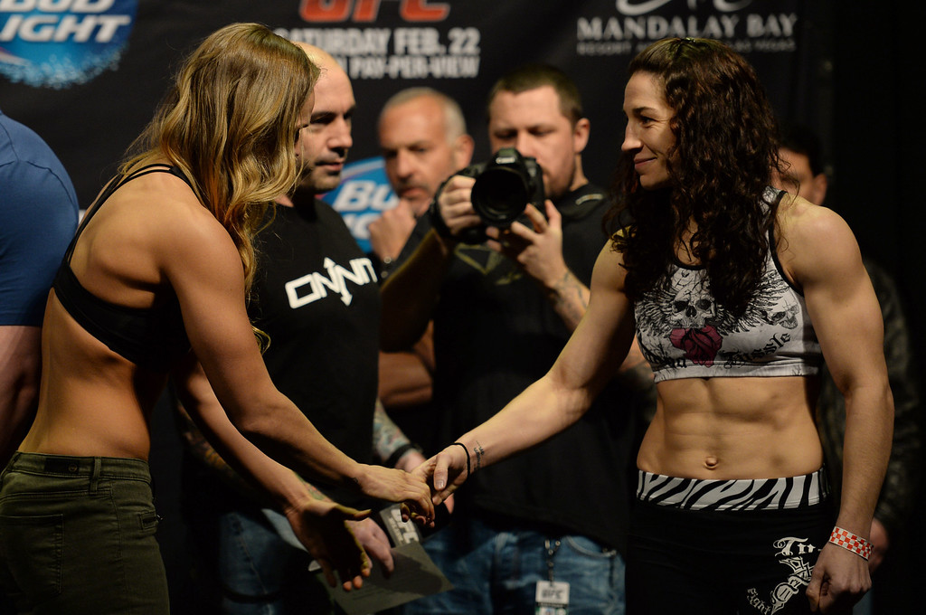 . Ronda Rousey and Sara McMann shake hands during weigh ins for UFC 170 at the Mandalay Bay Events Center in Las Vegas Friday, February 21, 2014. (Photo by Hans Gutknecht/Los Angeles Daily News)
