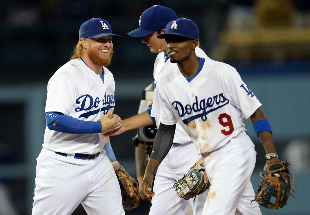 . The Dodgers� Justin Turner #10 gets a congratulatory handshake from Miguel Rojas #72 after winning their  game at Dodger Stadium Thursday, August 21, 2014. The Dodgrs beat the Padres 2-1. (Photo by Hans Gutknecht/Los Angeles Daily News)