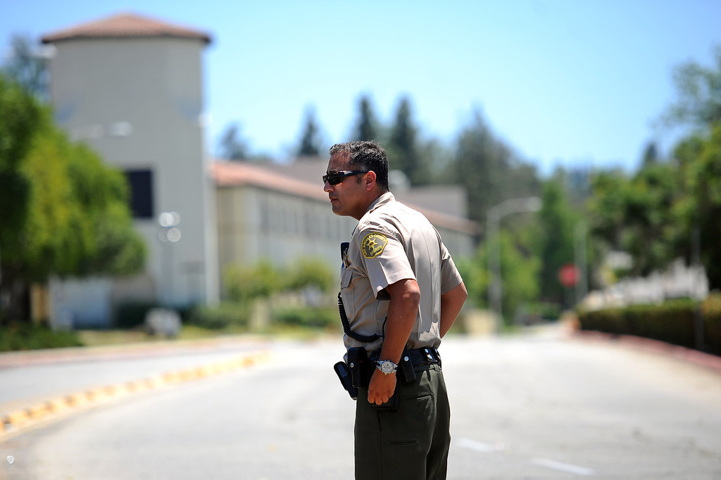 . A Sheriff deputy blocks an entrance at Pierce College May 30, 2014 in Woodland Hills.  A report of a suicidal man with a gun on campus created a lockdown situiation around noon.  The man was later found at Canoga Bowl.(Andy Holzman/Los Angeles Daily News)