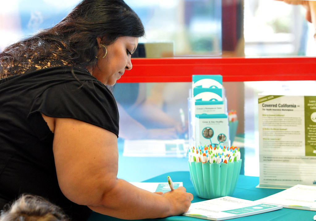 . (John Valenzuela/Staff Photographer) Rosa Rodriguez of Rialto signs-up to get more information about her health insurance options with Covered California at Molina Medical in Fontana, Tuesday, Oct. 1, 2013. Today kick off the first day of open enrollment for Covered CA, the marketplace for affordable, private health insurance, Molina Medical  hosted an informational event for its patients and the Inland Empire community.