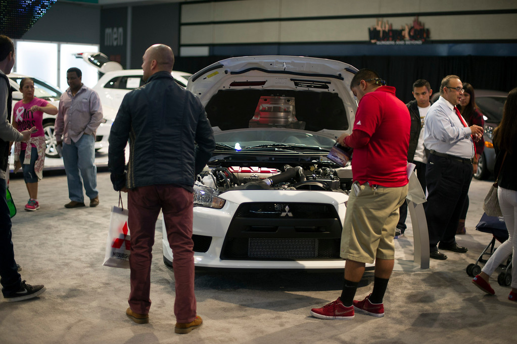 . People make their way through the Los Angeles Auto Show at the L.A. Convention Center Friday, November 22, 2013. (Photo by Hans Gutknecht/Los Angeles Daily News)