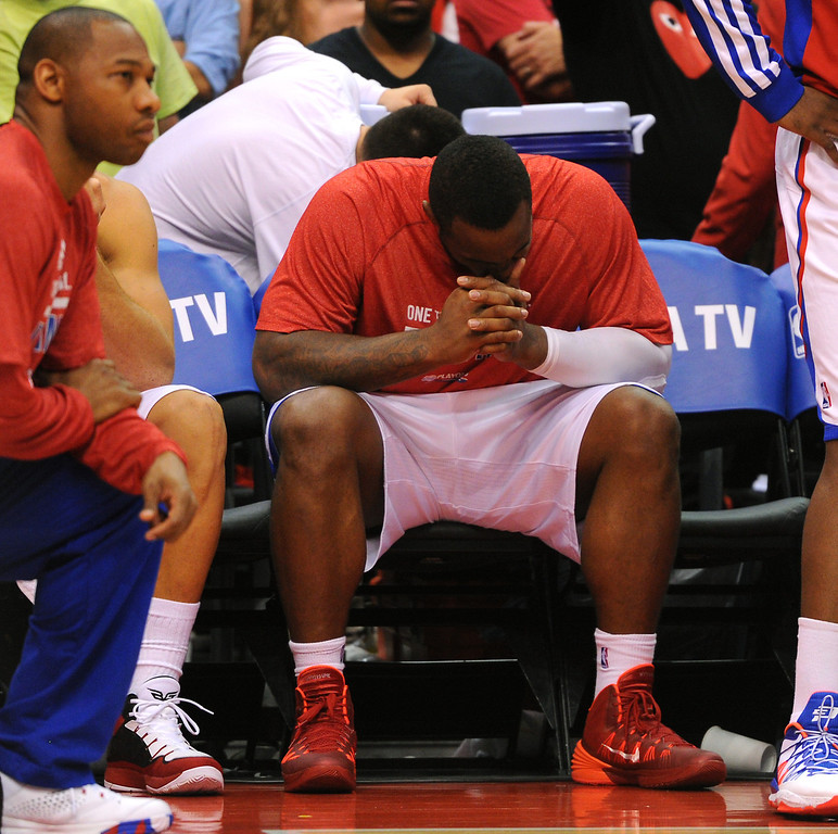 . The Clippers\' Glen Davis holds his head in the final minutes as they loose to the Thunder 104-98, Thursday, May 15, 2014, at Staples Center. (Photo by Michael Owen Baker/Los Angeles Daily News)