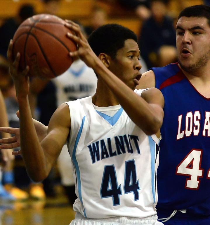 . Walnut\'s Richard Rycraw (C) (44) controls the ball past Los Altos\' Jayson Jones (44) in the second half of a prep basketball game at Walnut High School in Walnut, Calif., on Wednesday, Jan. 22, 2014. (Keith Birmingham Pasadena Star-News)