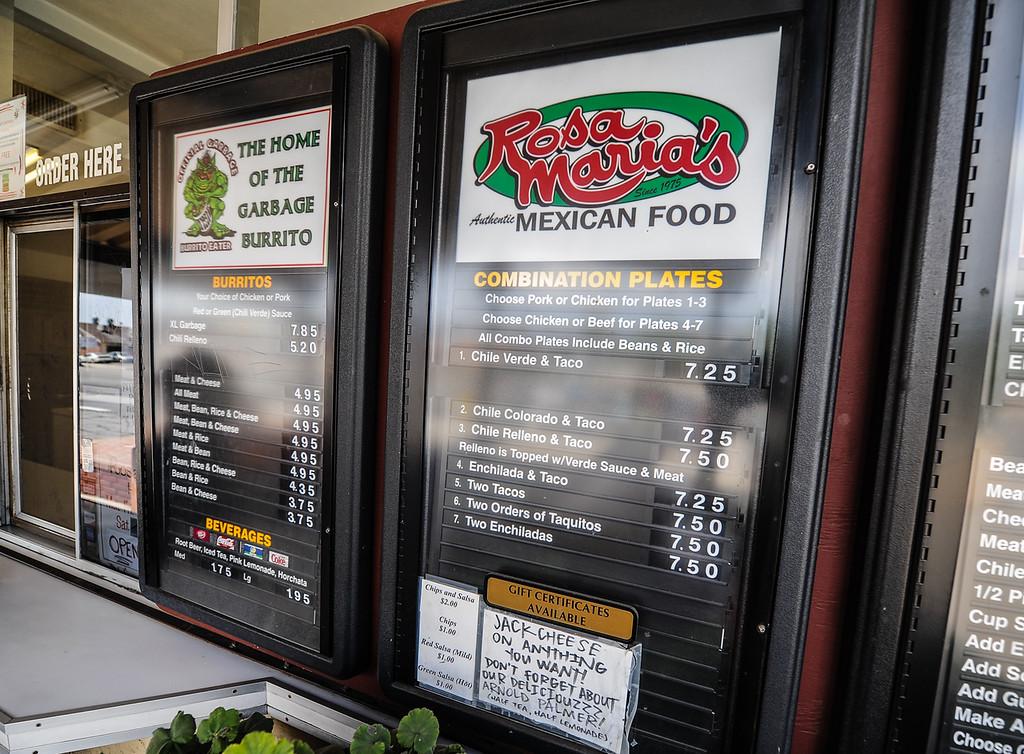 . Mexican food menu is displayed at Rosa Maria\'s in San Bernardino Wednesday, Sept. 4, 2013. Rosa Maria\'s is known for its exclusive Garbage Burrito menu item. (Photo by Rachel Luna / San Bernardino Sun)