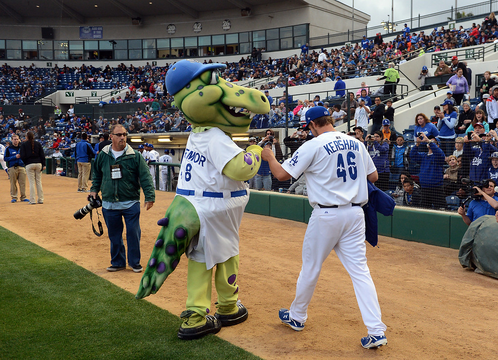 . The Dodgers\' Clayton Kershaw fist bumps Tremor before pitching for the Quakes at LoanMart Field in Rancho Cucamonga, CA, Friday, April 25, 2014. (Photo by Jennifer Cappuccio Maher/Inland Valley Daily Bulletin)