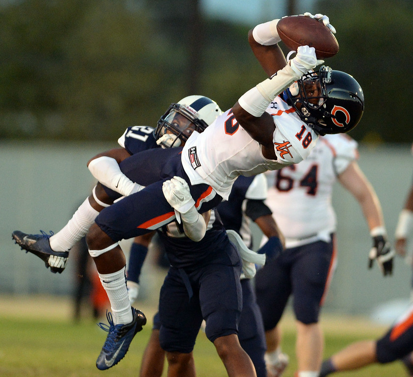 . Chaminade High School\'s Brandyn Lee #18 makes a catch over Venice High School\'s Skye Germaine #21 during their game at Venice High School in Venice Thursday, August 28, 2014. (Photo by Hans Gutknecht/Los Angeles Daily News)