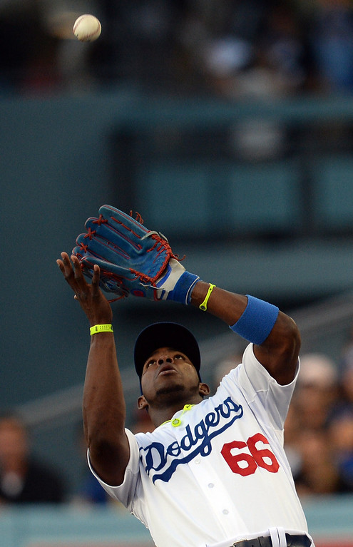 . The Dodgers\' Yasiel Puig #66 makes the catch of a foul fly ball during their game against the Giants at Dodger Stadium Friday, May 9, 2014. (Photo by Hans Gutknecht/Los Angeles Daily News)