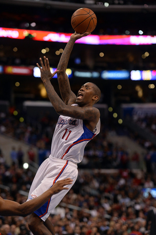 . The Clippers� Jamal Crawford #11 shoots during their game against the Raptors at the Staples Center in Los Angeles Friday, February 7, 2014. (Photo by Hans Gutknecht/Los Angeles Daily News)
