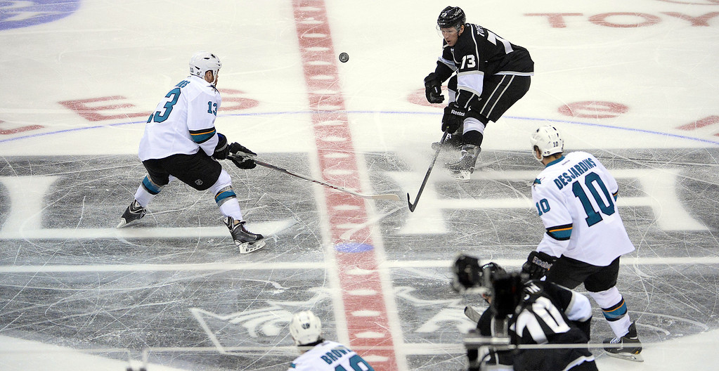 . San Jose Sharks left wing Raffi Torres (13) fights for the loose puck with Los Angeles Kings left wing Kyle Clifford (13) during the first period in Game 4 of an NHL hockey first-round playoff series at Staples Center in Los Angeles on Thursday, April, 24  2014.  (Keith Birmingham Pasadena Star-News)