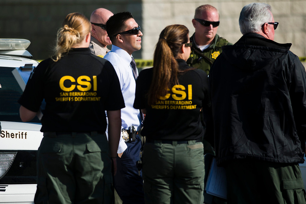 . Officials investigate the scene of a fatal deputy-involved shooting in 5400 block of Brushwood Court in Chino Hills on Friday, March 28, 2014. f(Photo by Watchara Phomicinda/ San Gabriel Valley Tribune)