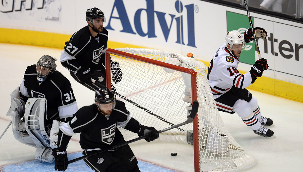 . The Blackhawks� Jonathan Toews #19 get one past Kings� goalie Jonathan Quick #32 for a first period goal during Game 3 of the Western Conference finals at the Staples Center on Saturday, May 24, 2014. (Photo by Hans Gutknecht/Los Angeles Daily News)